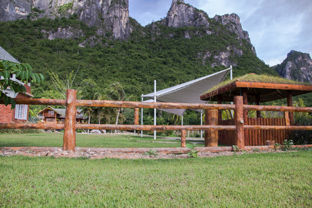 make public: Fence made of cement make it wood at national park,public