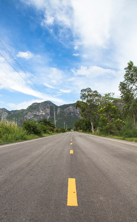 Straight country road to the mountain in Thailand,sam roi yod national park Stock Photo