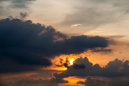 A stormy weather scene at sunset with against a burning sky Stock Photo