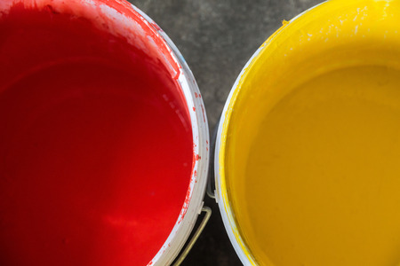 Close-up view of paint can on concrete floor Stock Photo