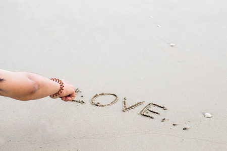 Write the word love letters on the sand,feeling Stock Photo