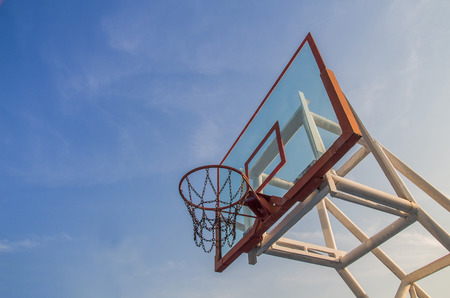 Photo of glass basketball hoop and blue sky background,basketball basket Stock Photo