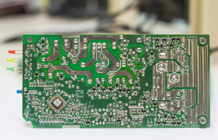 Closeup on electronic board power supply,blurred and toned image,focus on the device