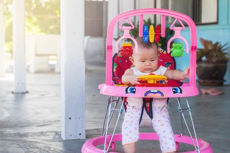 Little girl in a toy car cabin