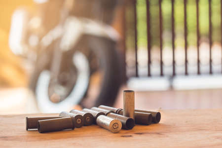 A set used to of old bullets and cartridges on wood background  Stock Photo