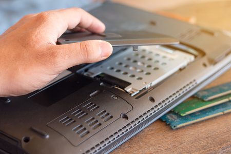 Repairman restores the laptop,Installing the hard drive hardware and check RAM, Electronic repair pc,technology renovation,concept repairs