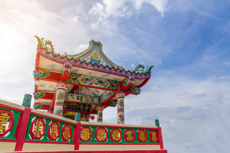 Ancient Chinese Shrine with Big Three face Guanyin statue and sky background,public landmark for tourist