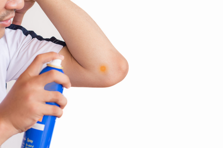 Man spray at elbow pain and feeling bad between exercise on white background,Health care concept