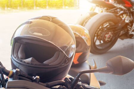 Man in a Motorcycle with helmet and gloves is an important protective clothing for motorcycling throttle control with sun light,safety concept
