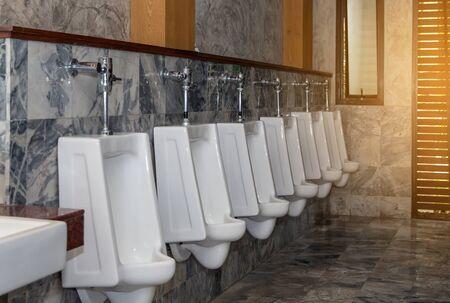 White urinal row in modern restroom interior,Urinals background