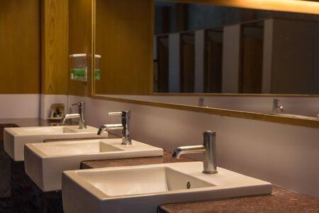White wash bowl row in modern restroom interior,wash basin background Stockfoto