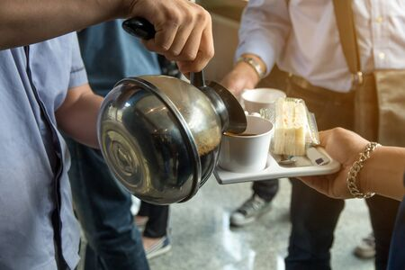 employees are served coffee break between meeting and snack on dish,coffee concept.