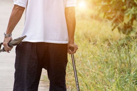Asian old man with walking stick or staff cane for patient or senior or elderly people at the front house,healthy medical concept Stockfoto