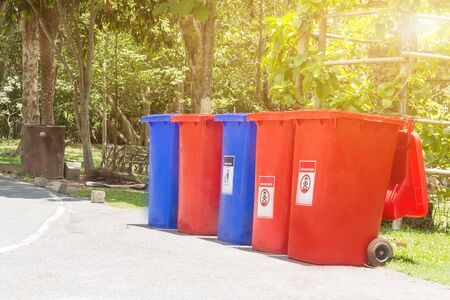 Garbage bins for recycling with recycle colors symbol in the park,Environmental pollution issues.