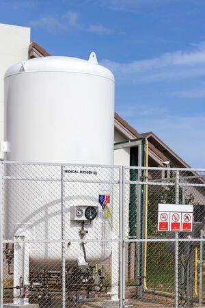 Liquid oxygen tank in hospital with warning label for safety control flammable,safety industrial concept