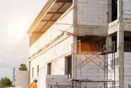 Construction site building with scaffolding on new house,architecture and high building constuction concept