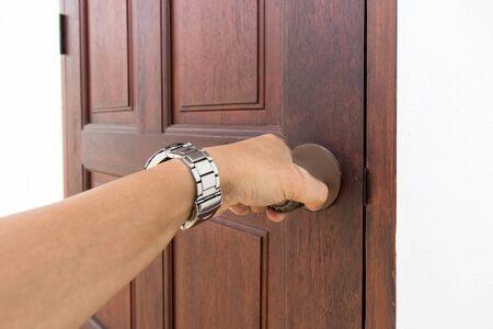 Hand of people open the door to inside, outside door open putting into front door