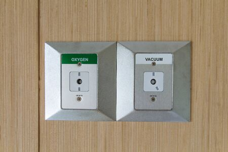 Closeup oxygen and vacuum plug sockets on the wall in a hospital patient room, Medical hospital oxygen inhalation device 写真素材