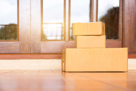 The goods package and sent to receiver at home,Delivery man holding boxes person who sent the package box to the recipient to arrive at home