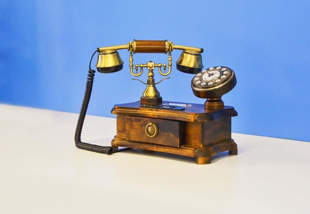 telephonic: The phone is designed in the style of an antique.