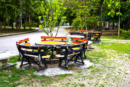 Outdoor table set in cement, making it popular for durability.