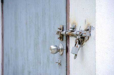 locked: The door was locked with bolts and locked with the keys again. Stock Photo