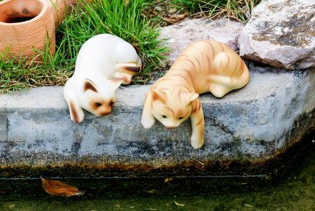 Cat statue was placed next to the pools.