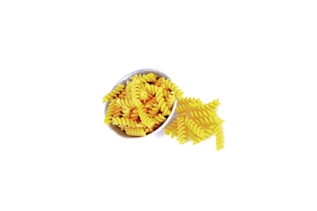 Macaroni was put in a bowl and placed on a white background.