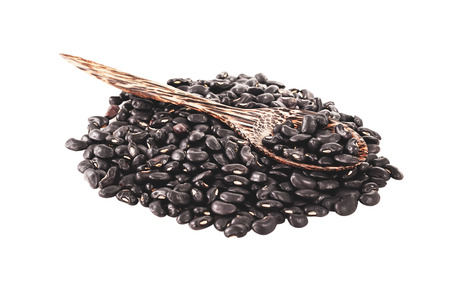 vigna: Black beans were placed on a white background.