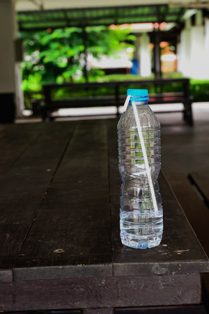 The water in the bottle was almost gone. Then put it on the table. Reklamní fotografie