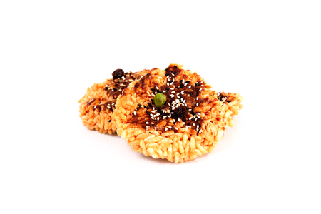 The rice is topped with sugar and the seeds are placed on a white background. Reklamní fotografie