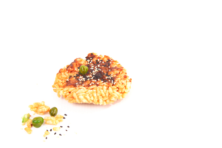 The rice is topped with sugar and the seeds are placed on a white background.