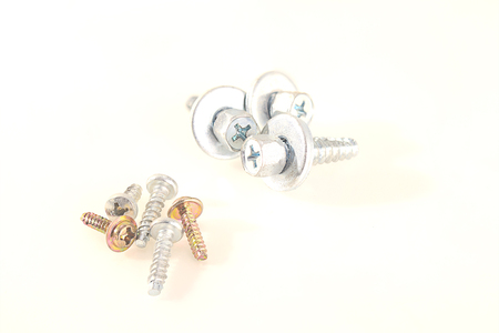 Nut screws are placed on a white background. Stock Photo