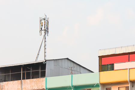 Phone antenna was developed to be small and can be installed on high-rise buildings where space is too small. Stock Photo