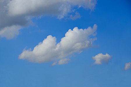 The clouds that float in the sky are caused by the condensation of the water, which changes in shape over time.
