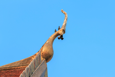 Gable apex on temple roof with blue sky background, Thailand Stock fotó