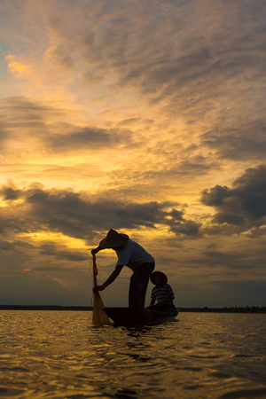 entrapment: Fishermen in action when fishing in the lake. Stock Photo