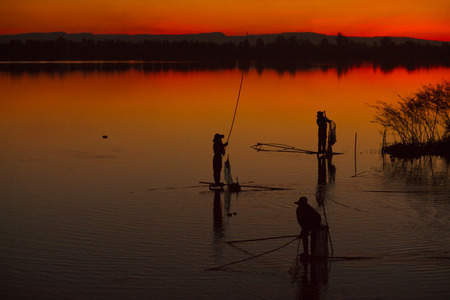 Fisherman in action when fishing in the lake.