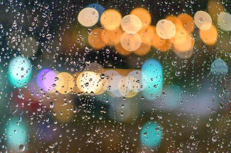 Today it rained down on the window. I live alone in a lonely place.While there is light passing through the window as bokeh. Stock fotó