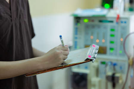 The specialist are checking continuous renal replacement therapy equipment and injection pump and hemodialysis machine.