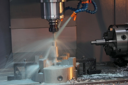 on the lathe: CNC Machine Stock Photo