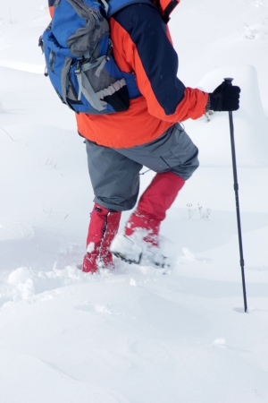 peccadillo: Alpinist walking in snow Stock Photo