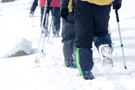 Alpinist walking in snow Stock Photo