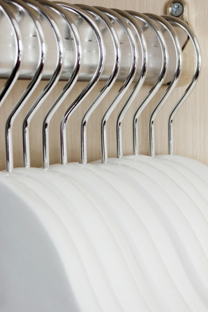 Empty clothes hangers Stock Photo