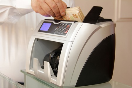 tl: Money counting machine Stock Photo