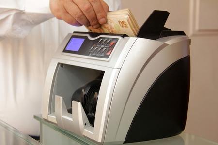 economic activity: Money counting machine Stock Photo