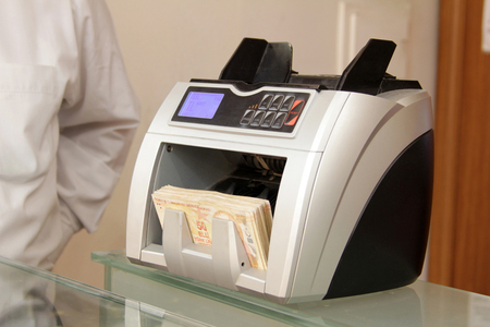 commercial activity: Money counting machine Stock Photo