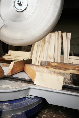 circular saw: Circular Saw Cutting a Wood Plank Stock Photo