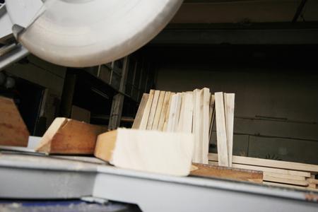 turning table: Circular Saw Cutting a Wood Plank Stock Photo