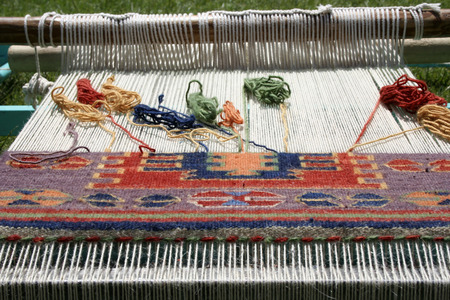 Loom for rug weaving
